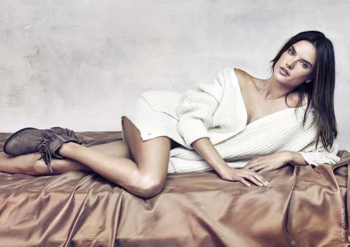 Alessandra Ambrosio flaunts her long legs in white sweater and XTI ankle boots