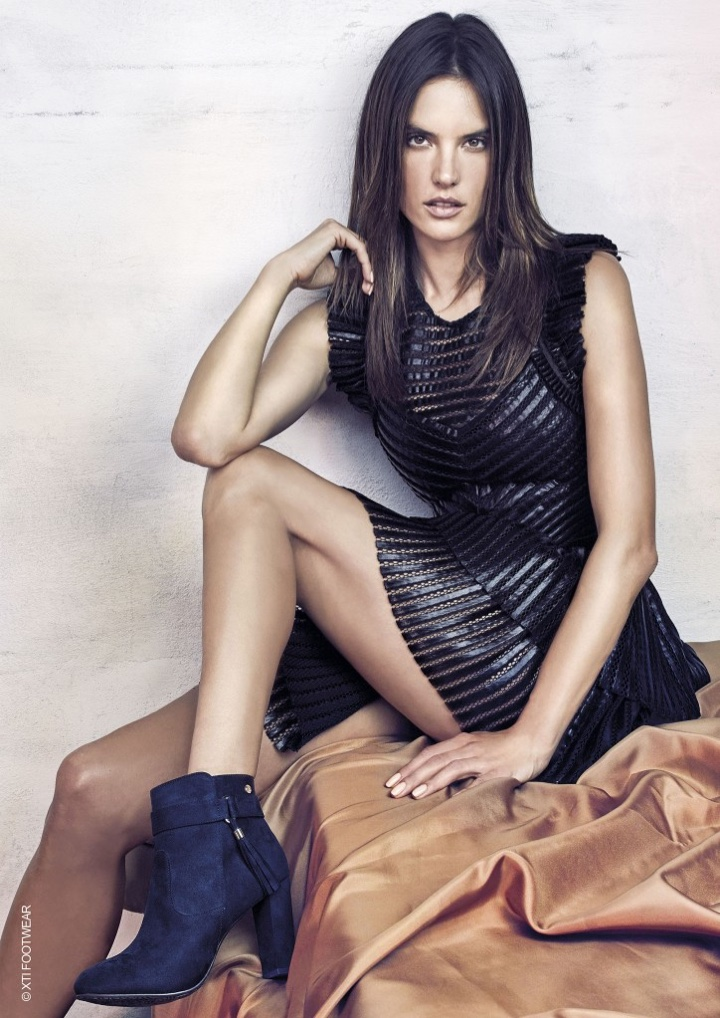 Alessandra Ambrosio wears tasseled booties from XTI Shoes