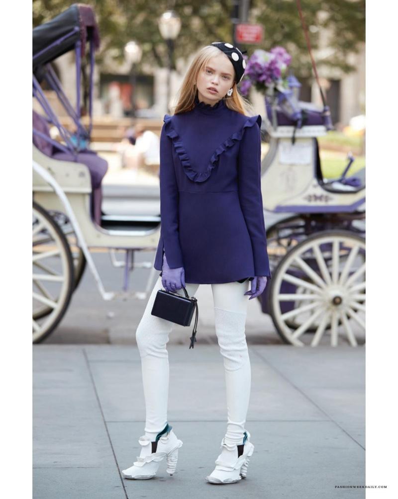 Nastya Siten poses in Fendi dress and heels
