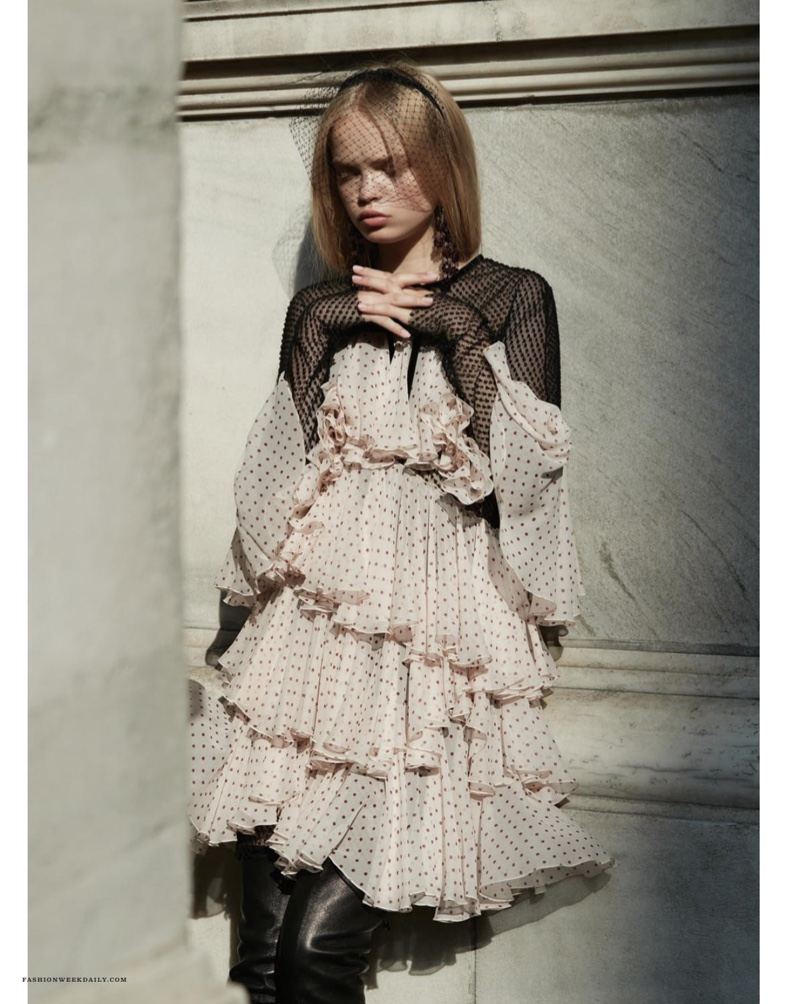 The blonde poses in Philosophy di Lorenzo Serafini georgette dress with tiered ruffles