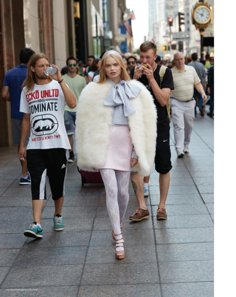 Natsya stands out from the crowd in fur cape with pastel hues