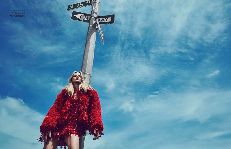 Anne Vyalitsyna models embellished red minidress from Roberto Cavalli with Thomas Wylde fur coat