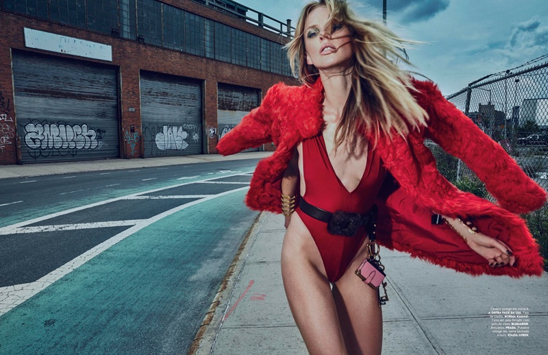Anne Vyalitsyna flaunts her long legs in a red swimsuit from Norma Kamali