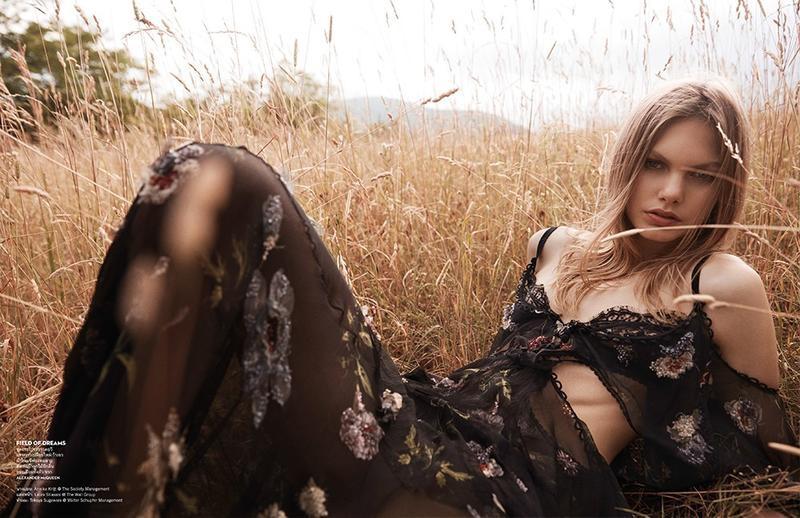 Annika Krijt models Alexander McQueen dress with open sleeves