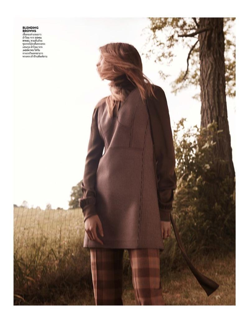 The model poses in Jason Wu dress over plaid Sonia Rykiel pants