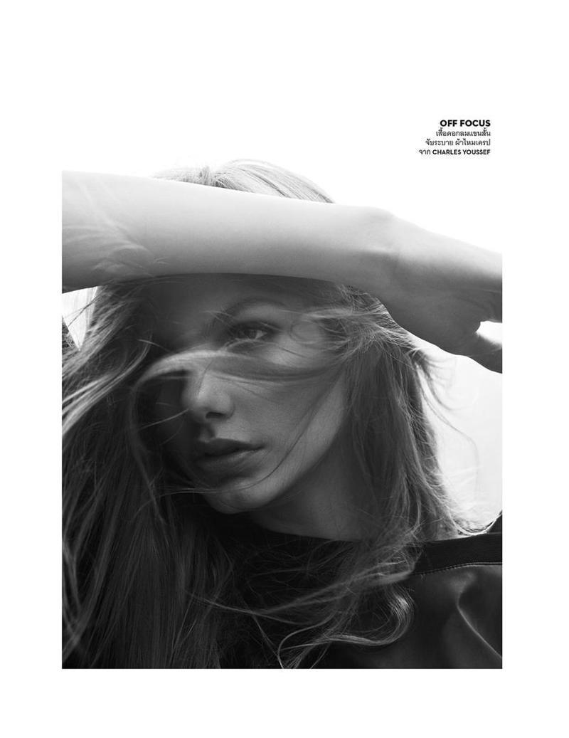 Model Annika Krijt gets her closeup in Charles Yousef top