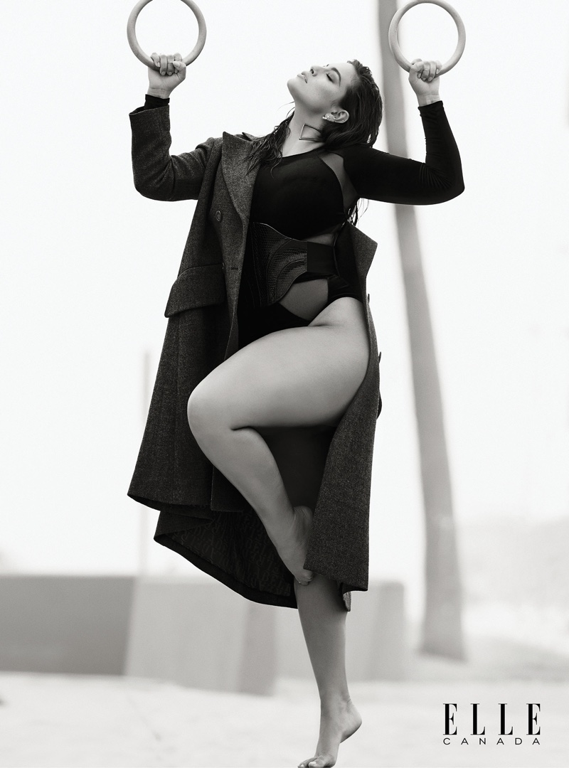 Ashley Graham wears Vivienne Westwood wool coat and velvet and mesh bodysuit