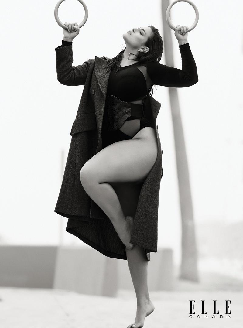 Ashley Graham wears Vivienne Westwood wool coat and velvet and mesh bodysuit