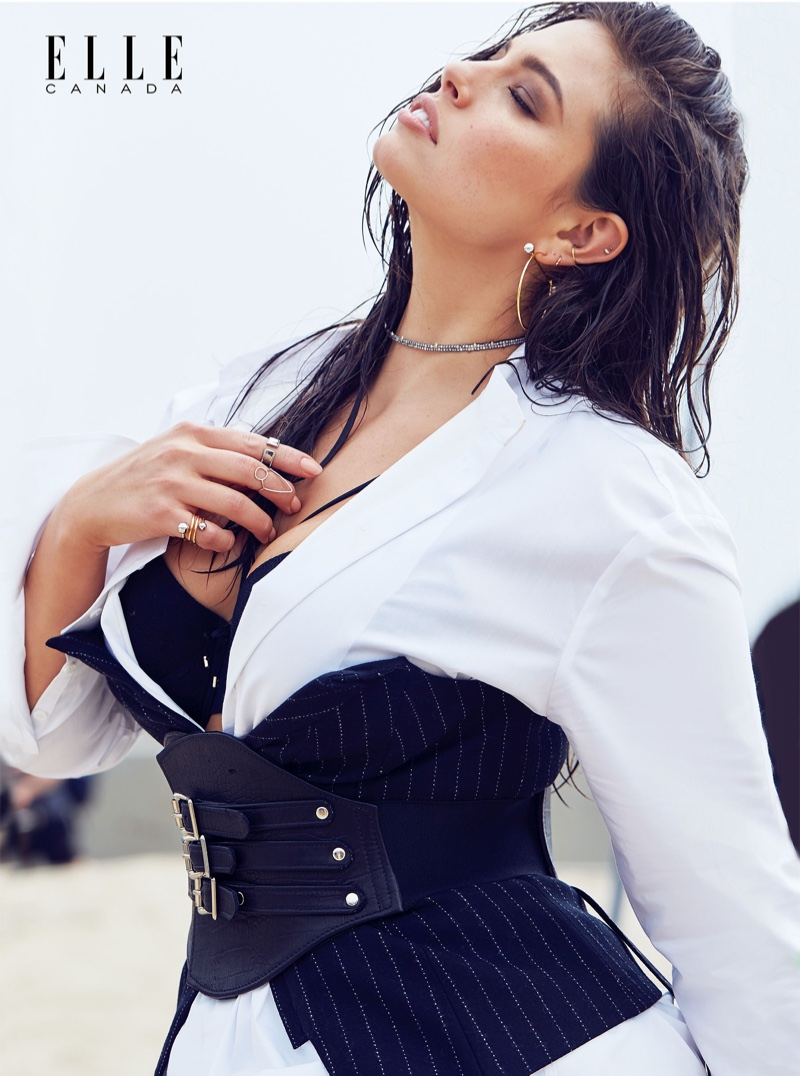Ashley Graham wears H&M Studio Collection cotton shirt and wool bustier with Ashley Graham for Addition Elle bra