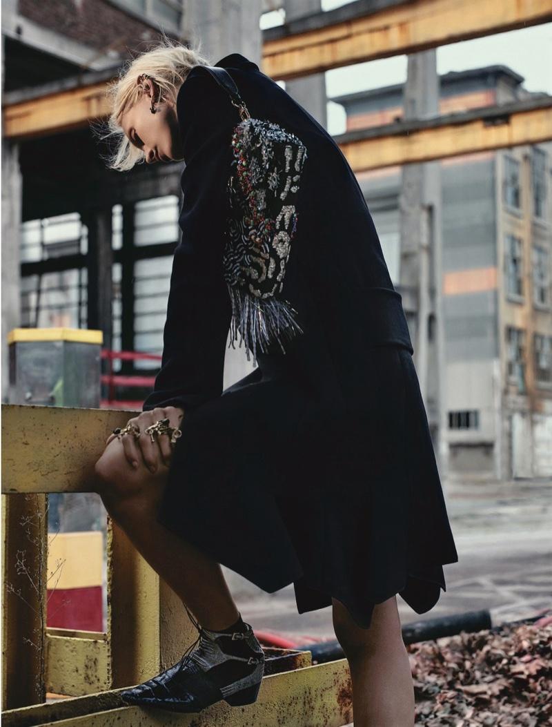 Aymeline Valade models Dior coat with embellished handbag