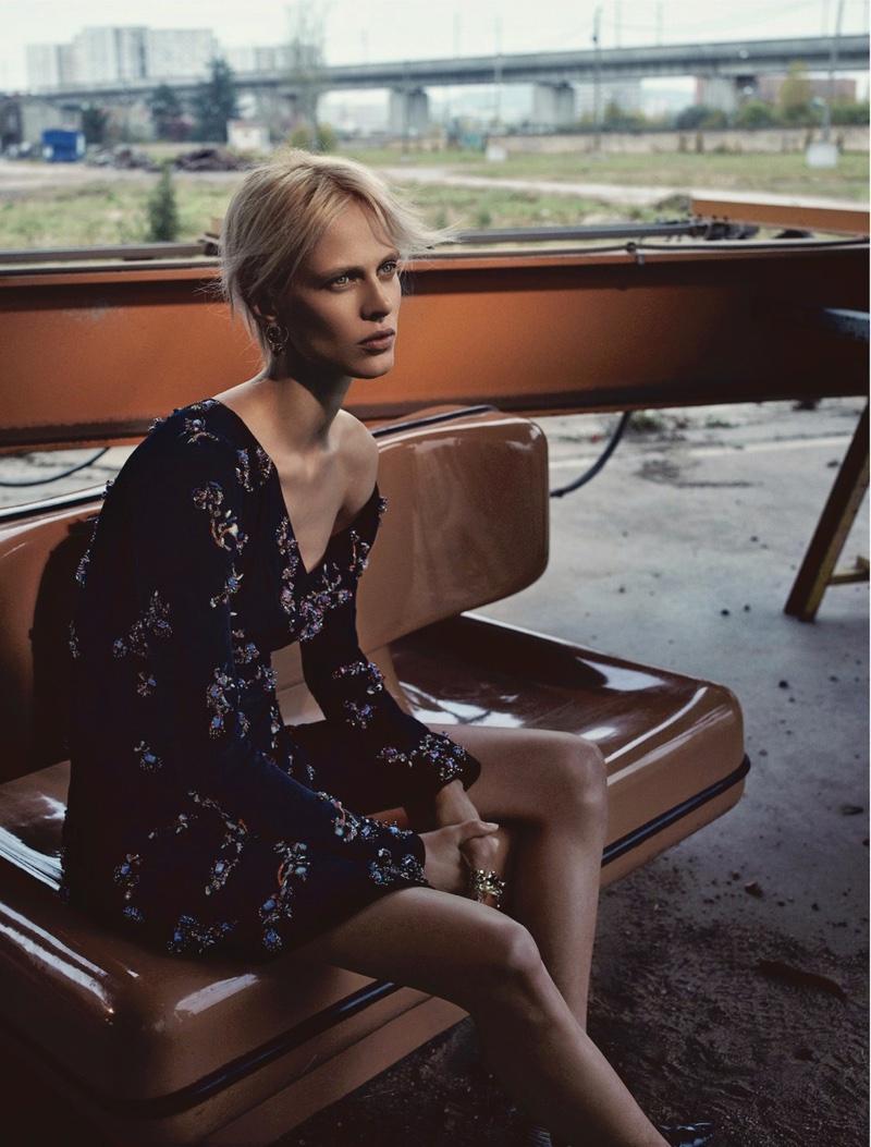 Model Aymeline Valade wears crystal adorned off-the-shoulder dress