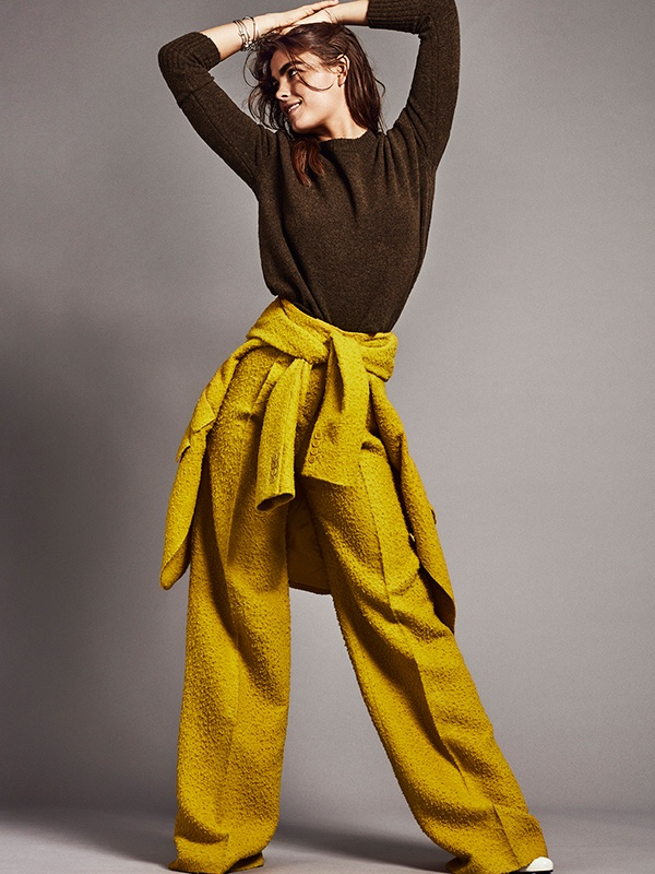The model takes on an athleisure look with pullover sweater and wide-leg trousers