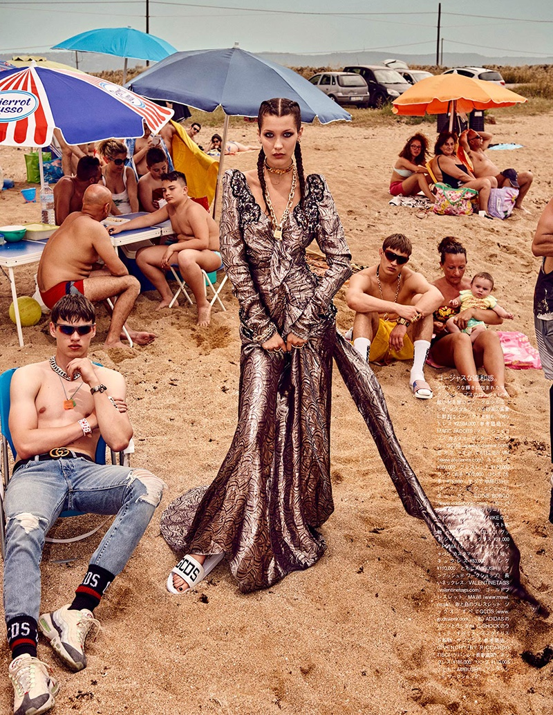 Model Bella Hadid wears a Marc Jacobs gown with GCDS sandals