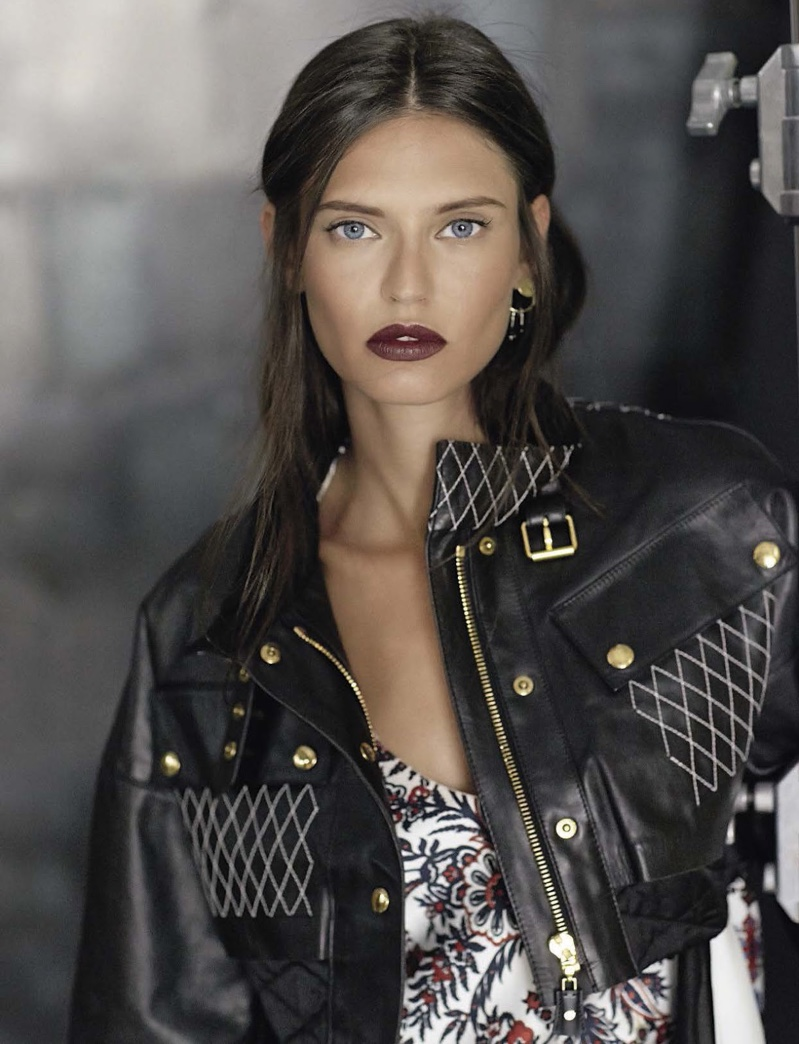 The model wears Louis Vuitton embellished leather jacket and printed dress
