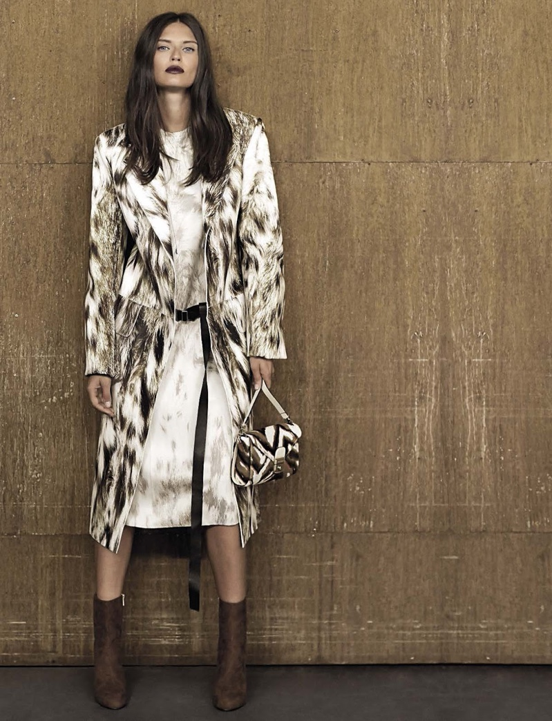 Bianca Balti models printed jacket and dress with ankle boots