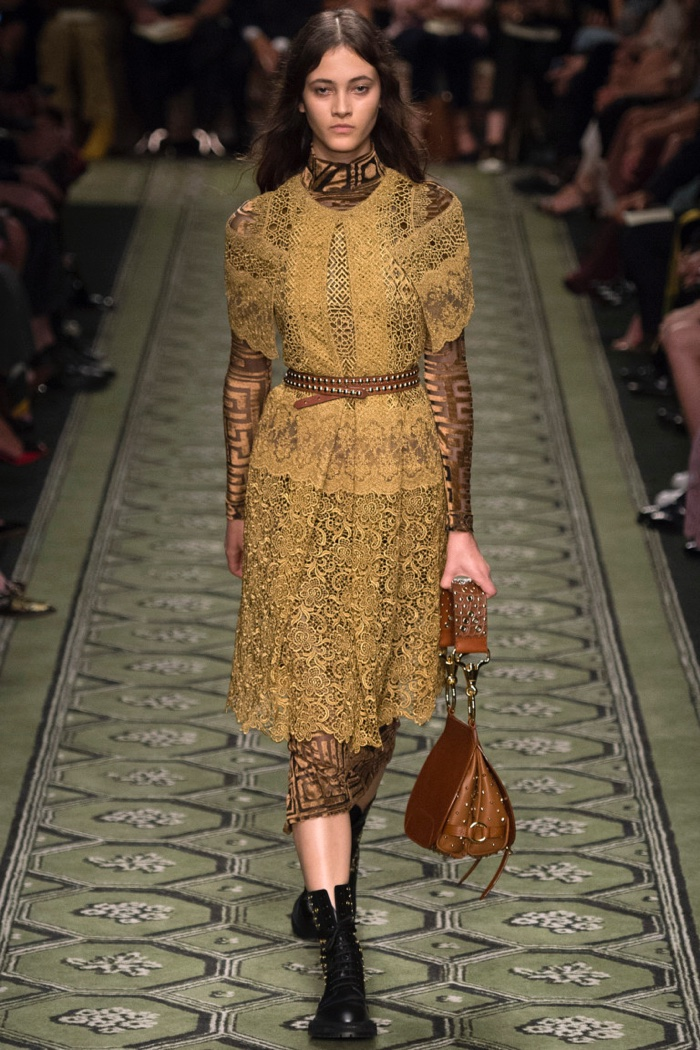 Burberry Fall 2016: Model walks the runway in lace dress over long-sleeve dress