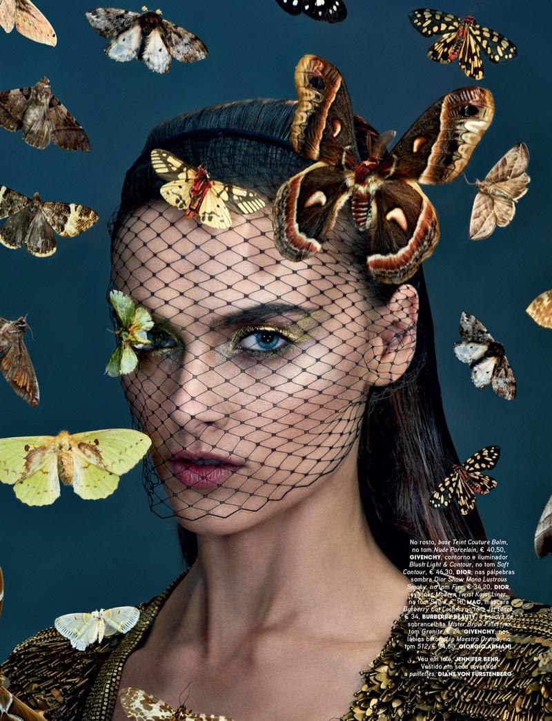 Zuzana Gregorova poses in Diane von Furstenberg paillette dress with gold eyeshadow look