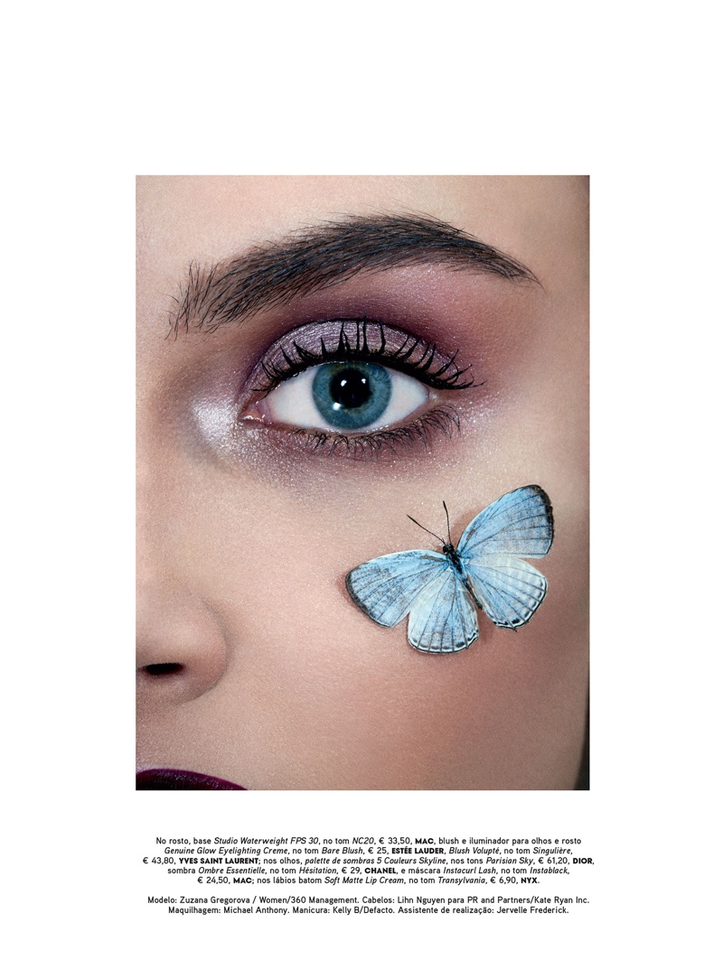 The model poses with butterfly on her face and glittery eyeshadow