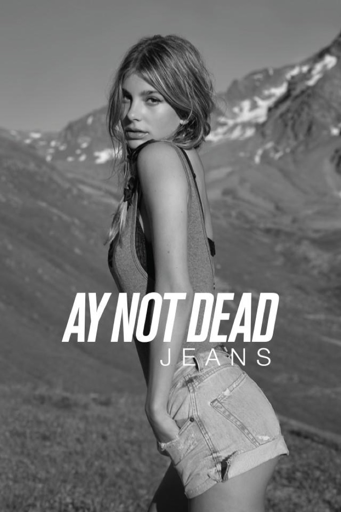 Camila Morrone wears denim shortalls in A.Y. Not Dead Jean's spring 2017 campaign