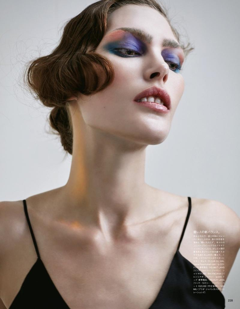 Catherine McNeil wears her hair in finger waves with multi-color eyeshadow