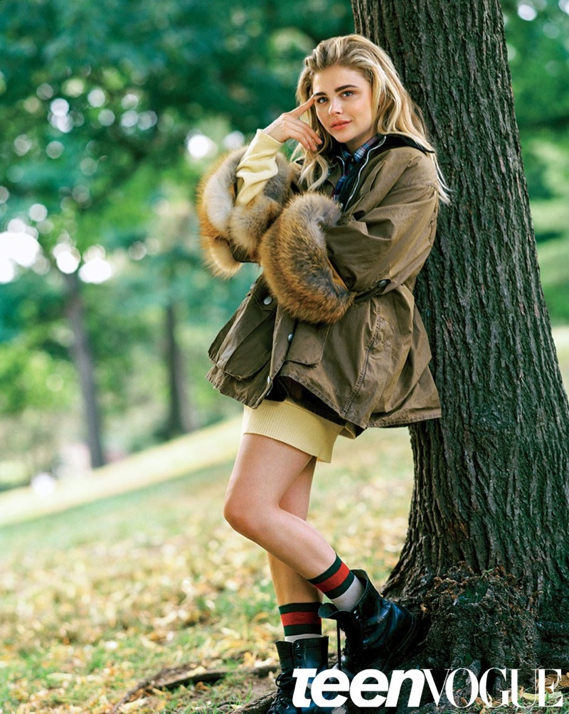 Chloe Grace Moretz wears parka with fur sleeves in the photo session