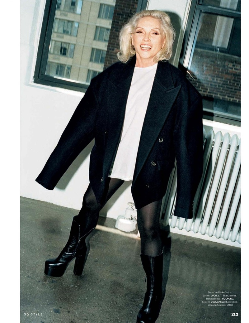 Debbie Harry wears a boxy jacket and tights look with platform boots