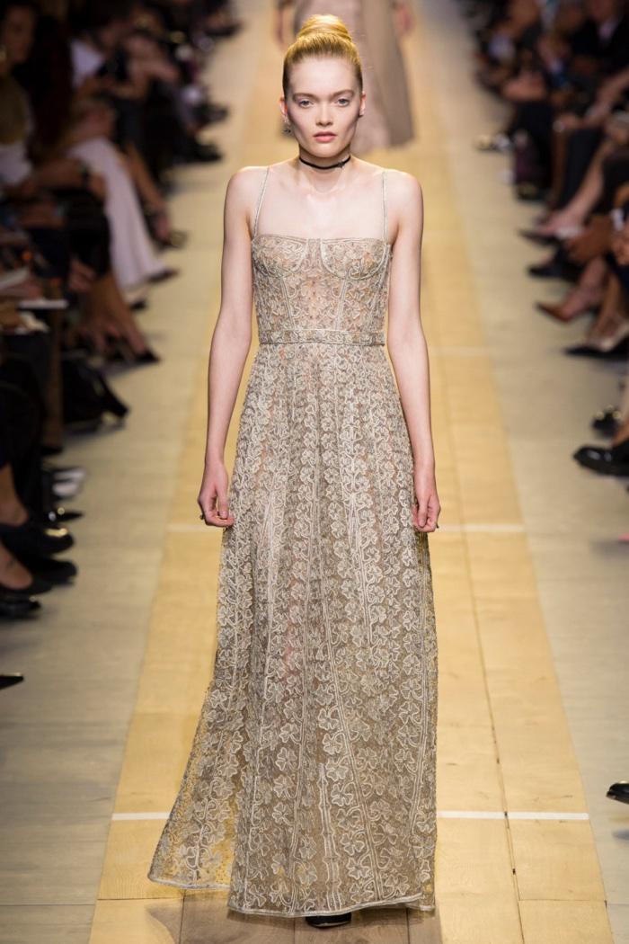 Dior Spring 2017: Model walks the runway in embroidered gown with bustier detail
