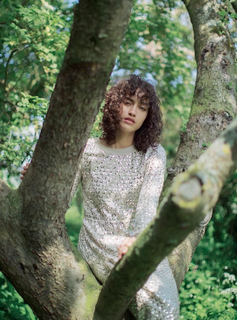 Posing in a tree, Allana wears white Chanel dress