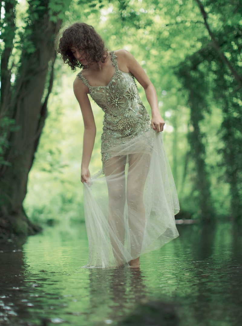 The model goes barefoot in Alexander McQueen gown