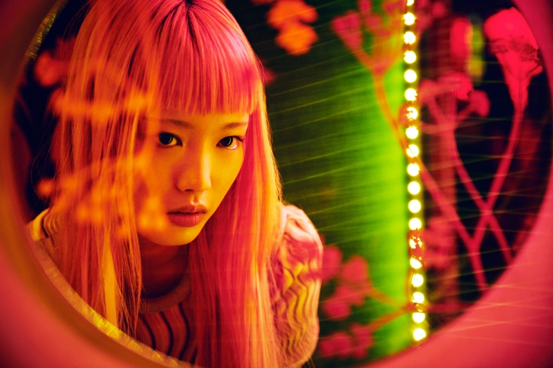 Pink haired model Fernanda Ly poses in fall collections