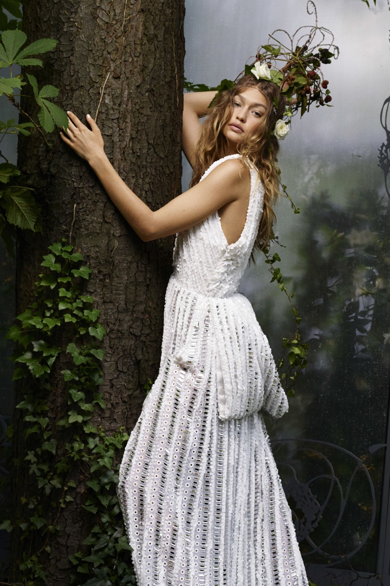 Gigi Hadid models paillette adorned Givenchy Haute Couture by Riccardo Tisci dress