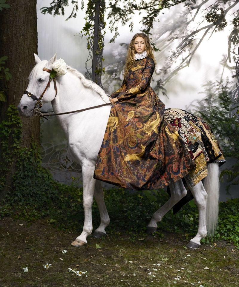 Posing on the back of a horse, Gigi Hadid models Valentino Haute Couture gown with ruffled collar