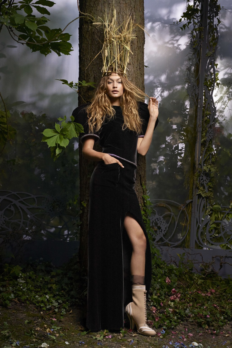 Gigi Hadid looks like a wood nymph in Armani Privé top and skirt with Fendi Haute Fourrure boots