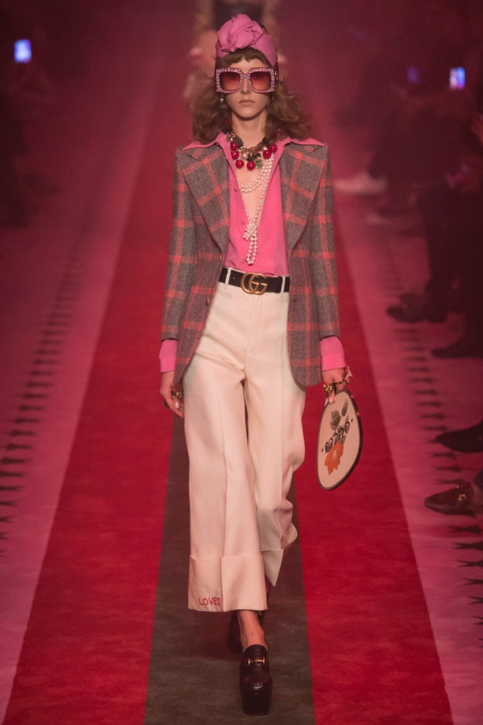 Gucci Spring 2017: Model walks the runway in windowpane suit jacket, pink blouse and cropped trousers
