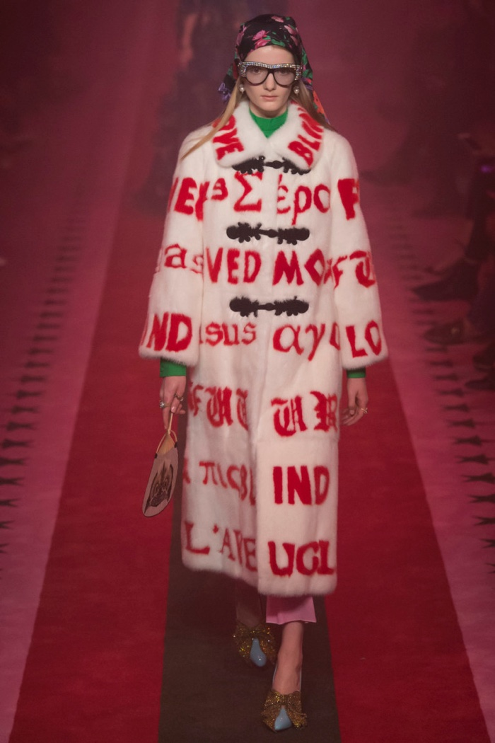 Gucci Spring 2017: Model walks the runway in fur coat with red embroidery