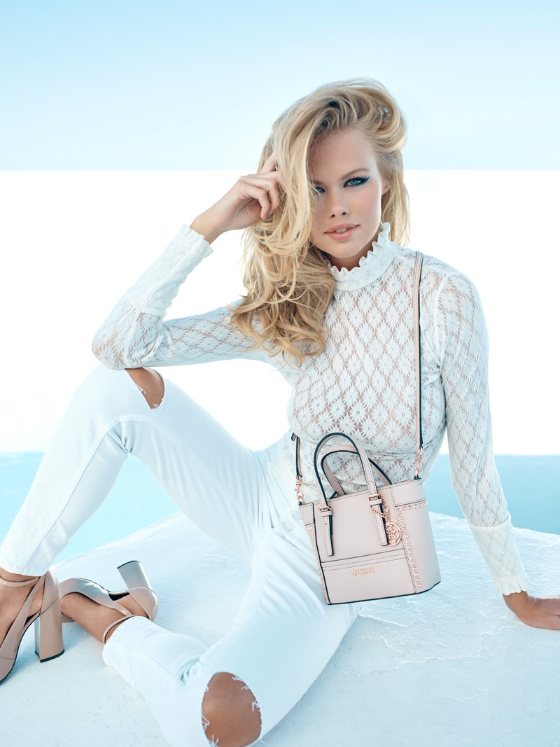 Emma Stern Niesen poses with a pop of pink for Guess Accessories' fall-winter 2016 campaign