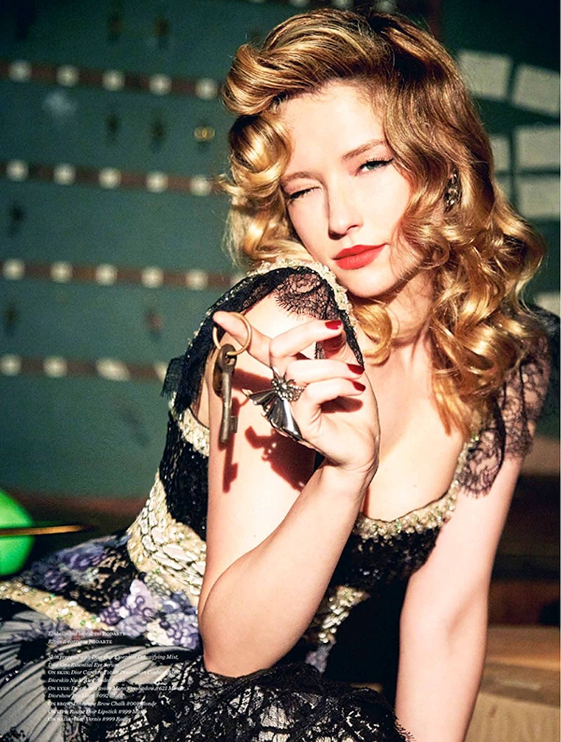 Actress Haley Bennett gives a wink in Rodarte lace dress and jewelry