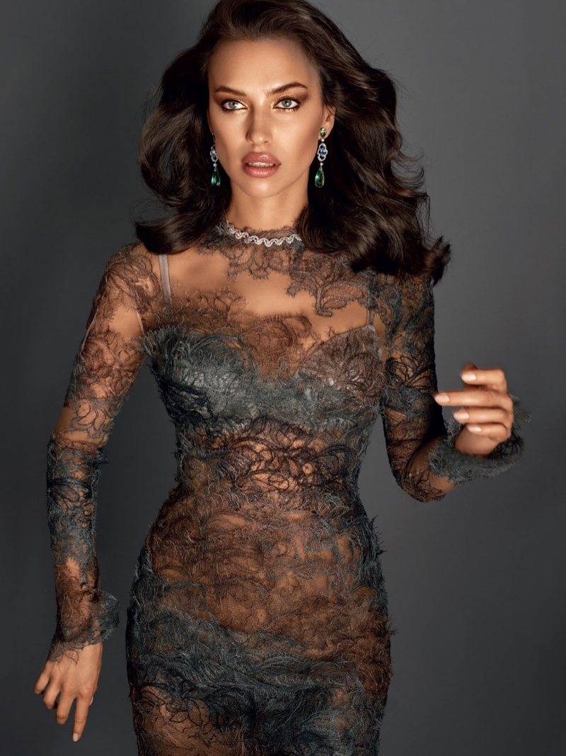 Model Irina Shayk poses in sheer lace dress