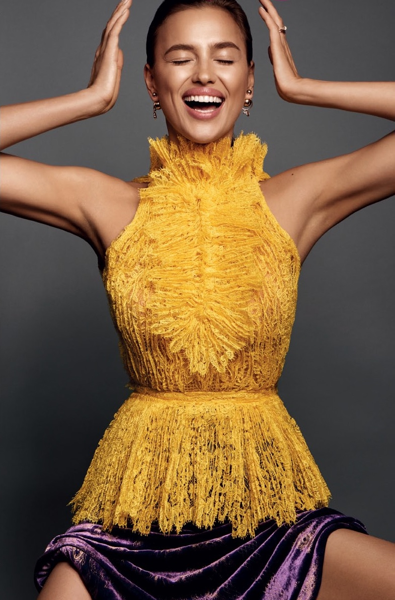 Irina Shayk flashes a smile in yellow lace top