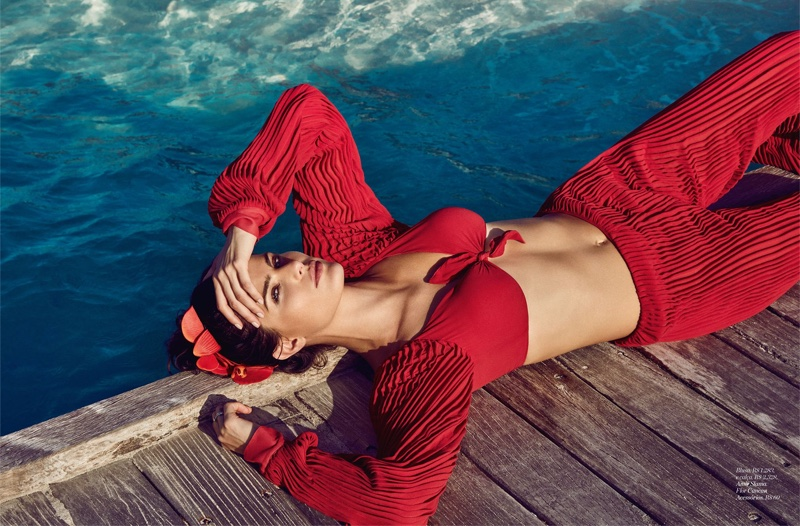 Model Isabeli Fontana looks red-hot in Amie Slama blouse and pants