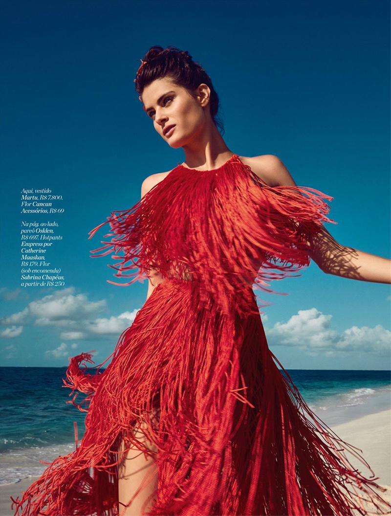 Proving fringe is in, Isabeli Fontana poses in red Martu gown