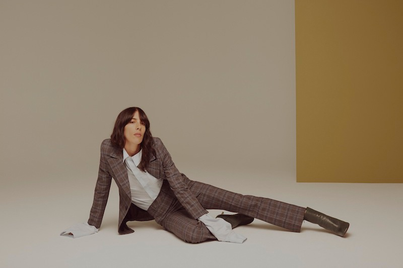 Jamie Bochert poses in Vetements suit, shirt and boots