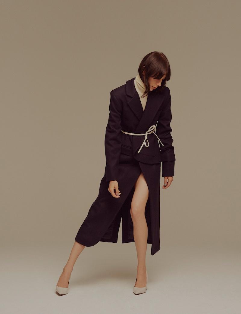 Model Jamie Bochert wears Jacquemus coat and Marni heels
