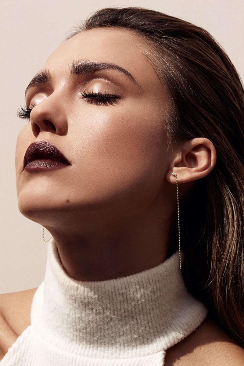 Jessica Alba wears a dark plum lipstick shade in the feature