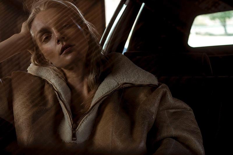 Posing in a car, Jessica Stam models Chloe cape
