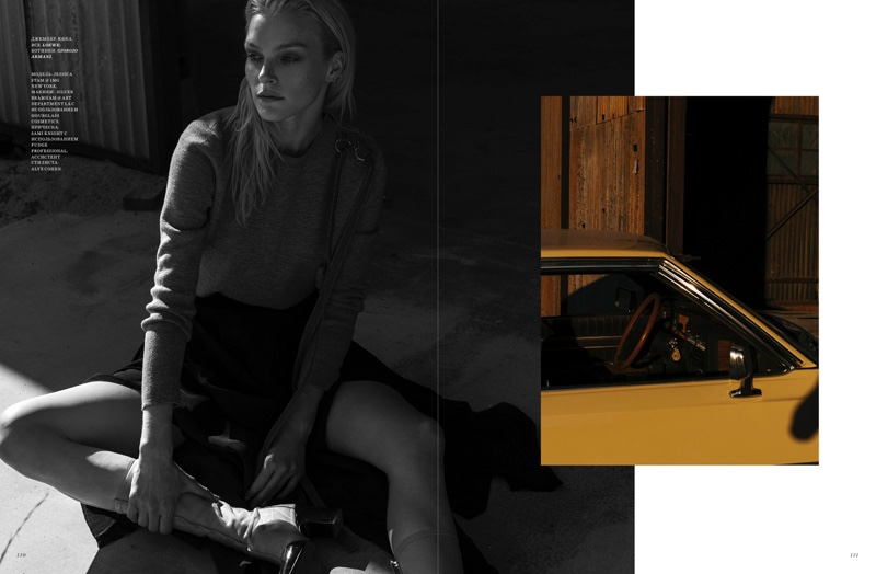 Jessica Stam models Loewe look with Giorgio Armani boots