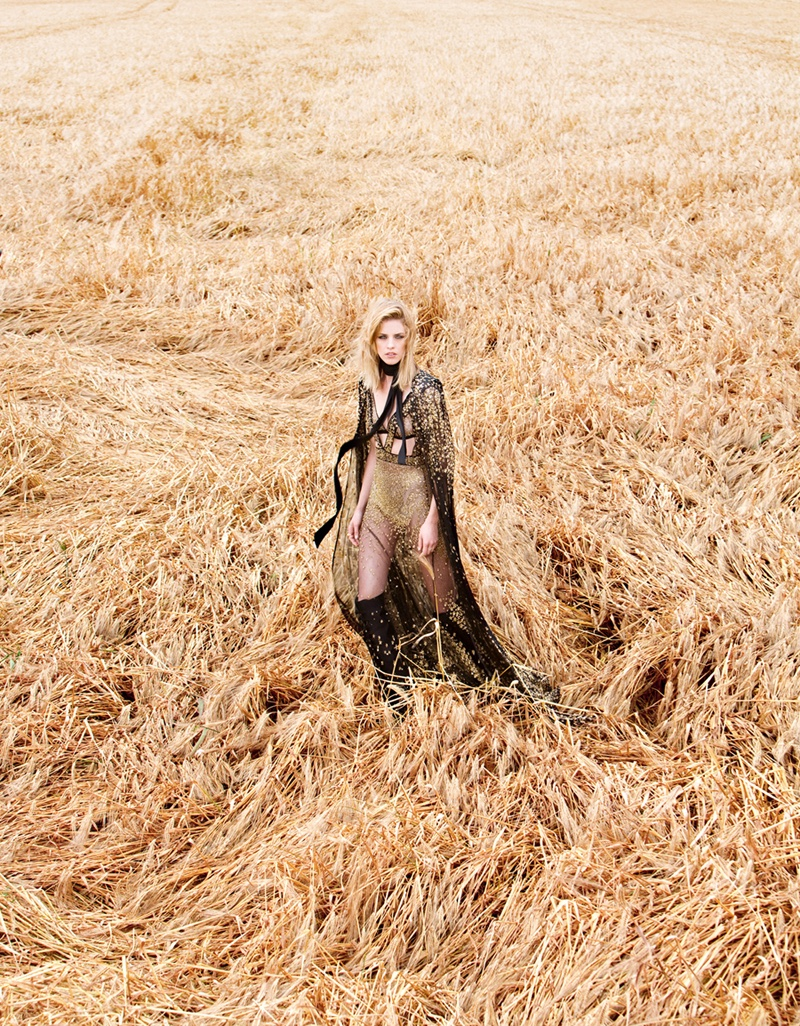 Photographed by Julien Vallon, the model poses in bohemian inspired fashions