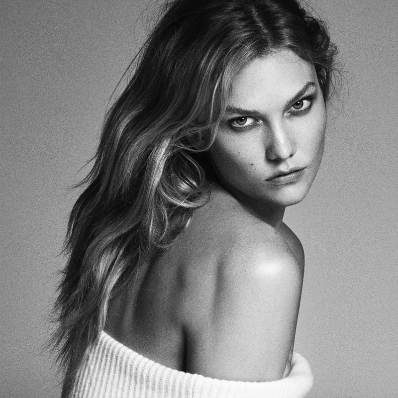 Karlie Kloss wears her hair in tousled tresses while giving a smoldering stare to the camera