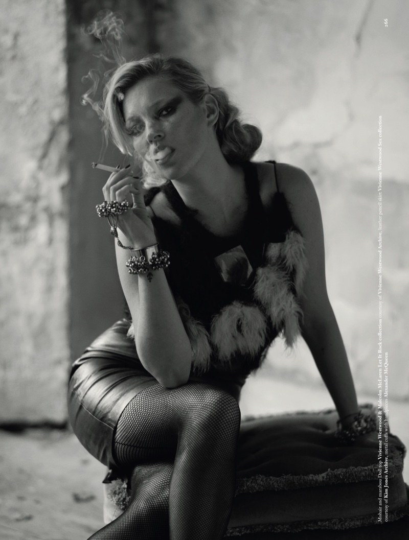 Enjoying a smoke, Kate Moss models Vivienne Westwood  & Malcolm McLaren Let It Rock collection top and Vivienne Westwood Sex collection leather pencil skirt