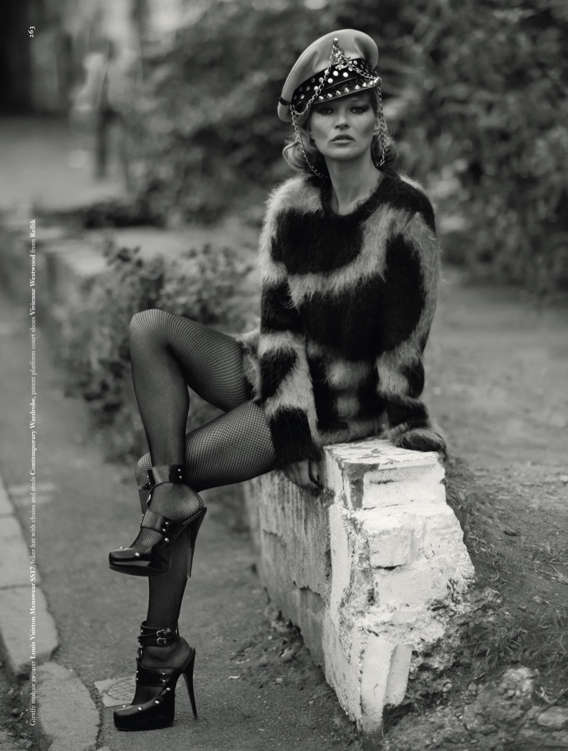 Kate Moss models Louis Vuitton sweater with Vivienne Westwood platform heels